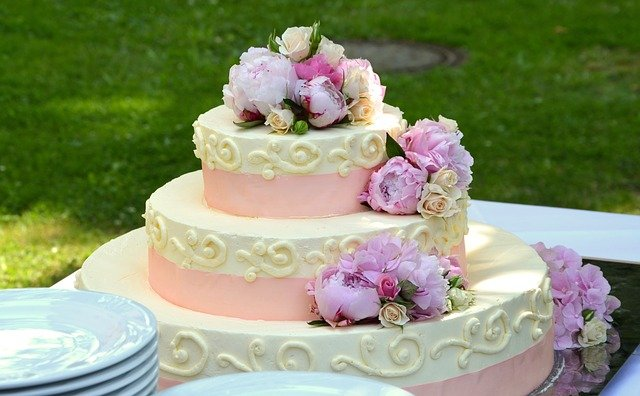 A flower sits in a piece of cake sitting on top of a table