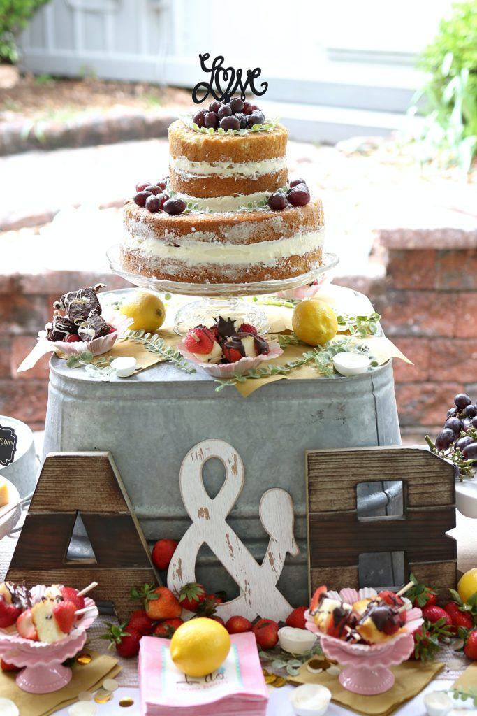 A cake with fruit on top of a table
