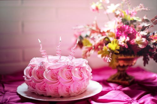 A bouquet of pink flowers on a table
